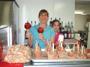 HOMEMADE LIKE THE OLD DAYS—Tracie and Delanie Riebschleger show off some of the good, homemade treats offered at The Sweet Tooth.