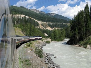 ALL ABOARD!—Squire photographer Cliff Hill hangs from an observation platform to capture this picture of the Rocky Mountaineer Train en route to Banff AL, Canada.