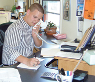 Mitch Harvatin, who will be going into the 10th grade at Rockford High School, is the newest intern reporter for The Rockford Squire, answering the phones and taking some notes on a news tip.