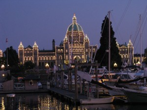 Picture at dusk of the Parliament Building outlined in thousands of lights.  Pic was taken from across the yacht basin and Inner Harbour which the building overlooks.