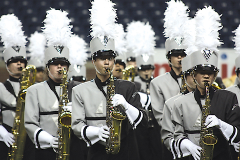 """Rockford High School's marching band scores 84.9 for their performance of """"The Four Freedoms"""" at the MCBA state championship, earning them third place."""