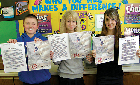 Essay contest winners (l–r) Grant Goodfellow, Annah Hillary and Katie LaBarge earn first-, second- and third-place awards for Assumption School in Belmont. All three received award certificates.