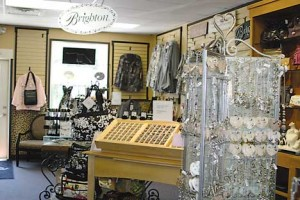 BOATLOADS OF BRIGHTON—Kimberly's Boutique in downtown Rockford is the largest Brighton department in the area. Owner Kimberly Smith even received an all-expenses-paid trip to the Brighton factory in California to see their quality work in person.