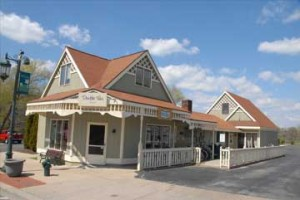 Double Take is the current resident of the original train depot building, built when the village was named Laphamville.