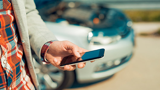 Man texting to request collision repair
