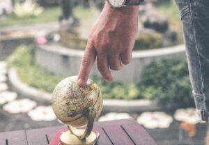 person-holding-terrestrial-globe-scale-model-taken-1079033