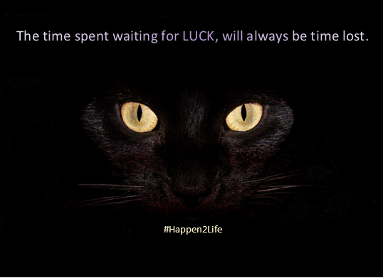 Image of a black cat with bright wide eyes. Includes #Happen2Life