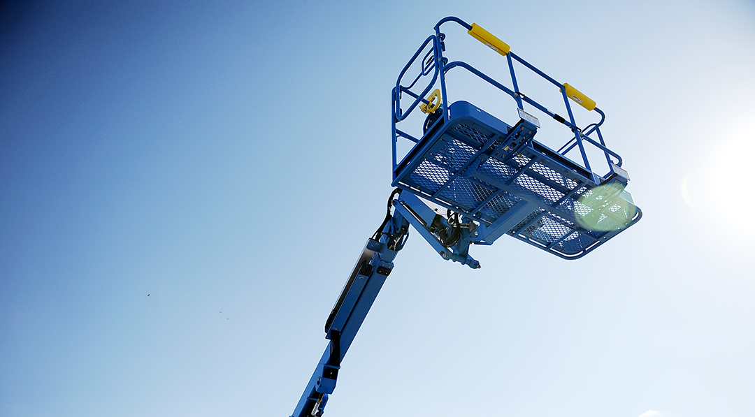 Genie S45 telescopic boom rental with man basket in the air