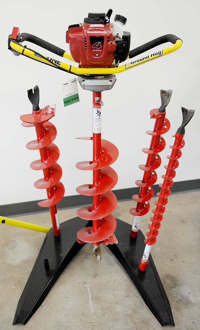 Ground Hog one man auger rental with various attachments