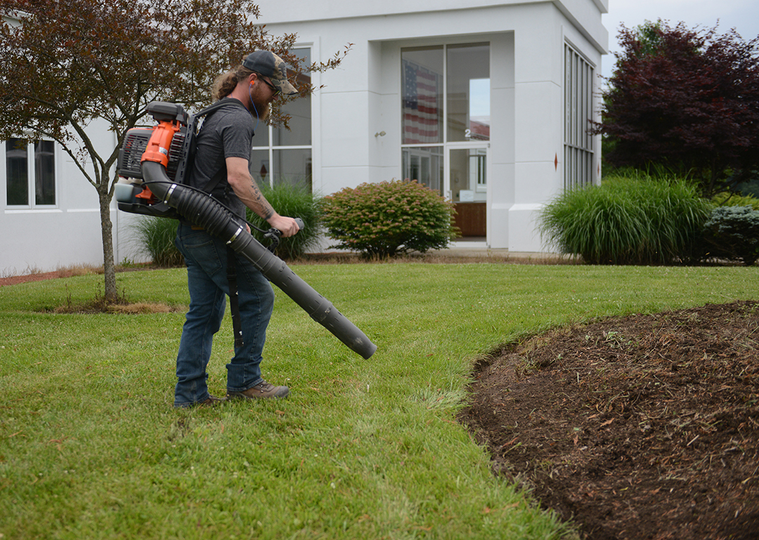 Use a leaf blower to rid the entire bed edge line of debris