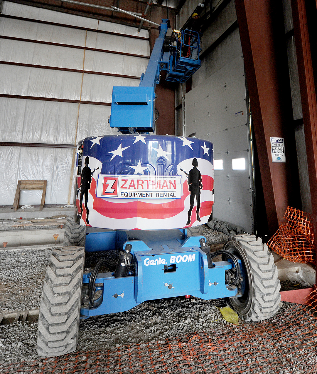 Genie Z45-25JRT articulating boom lift with patriotic wrap