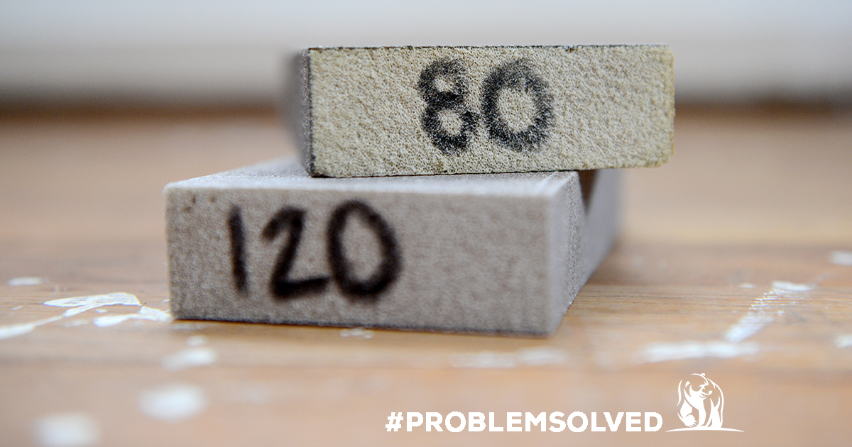 Sanding blocks with grit number written on ends.