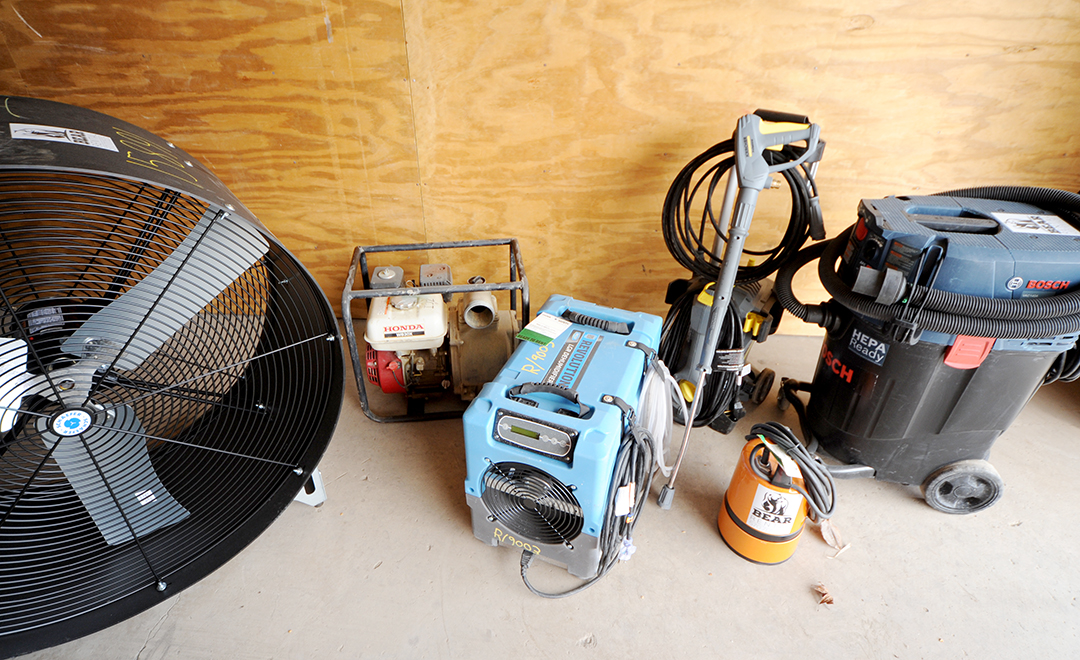 Tools needed to clean up a flooded basement include a fan, a sump pump, wet/dry vacuum and dehumidifier.