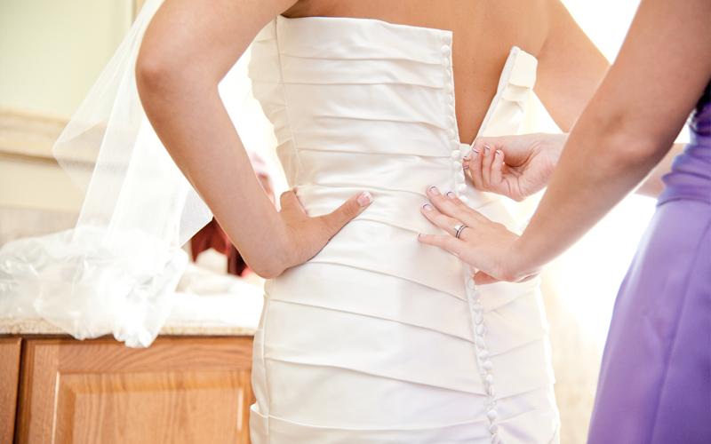 Bridesmaid Zipping Up Dress
