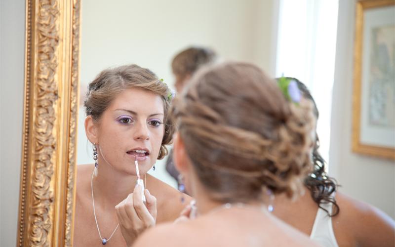 Bride Putting on Lip Gloss