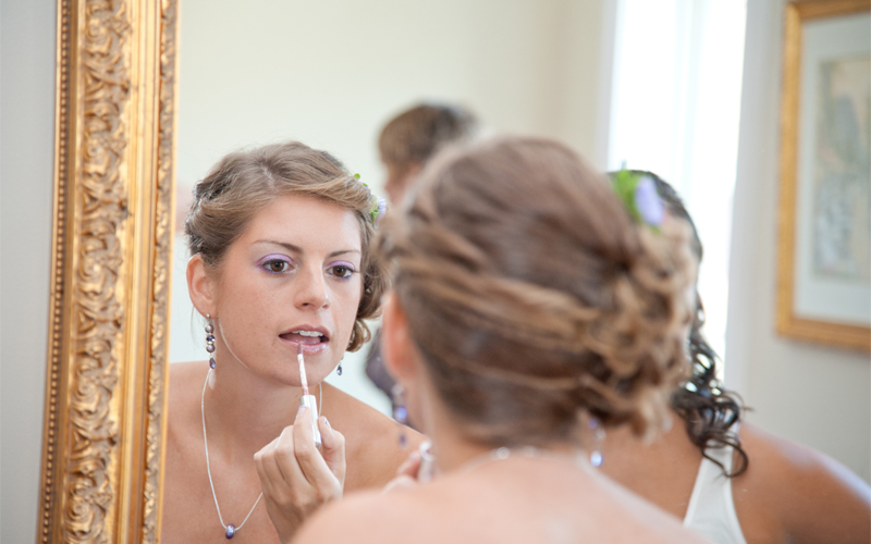 Bride Putting on Lip Gloss