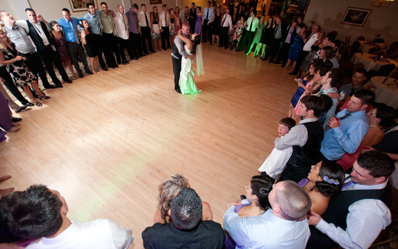 Huge Circle of Guests Watching Bride and Groom Dance
