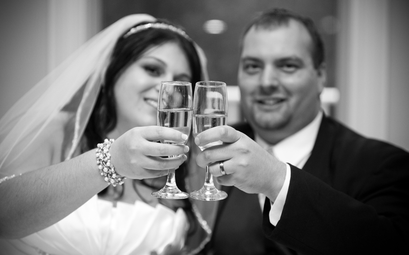 B&W of Bride and Groom Toasting