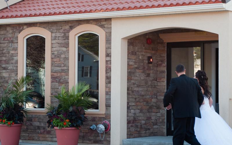 Bride and Groom Entering Testa's