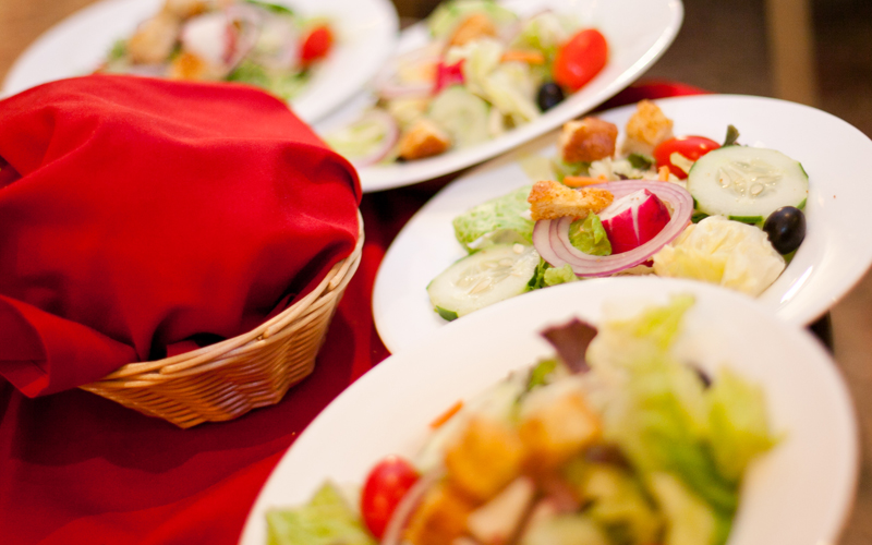 Passing Out Salad to the Guests