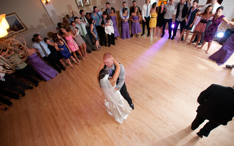 Last Dance with Guests Surrounding Couple