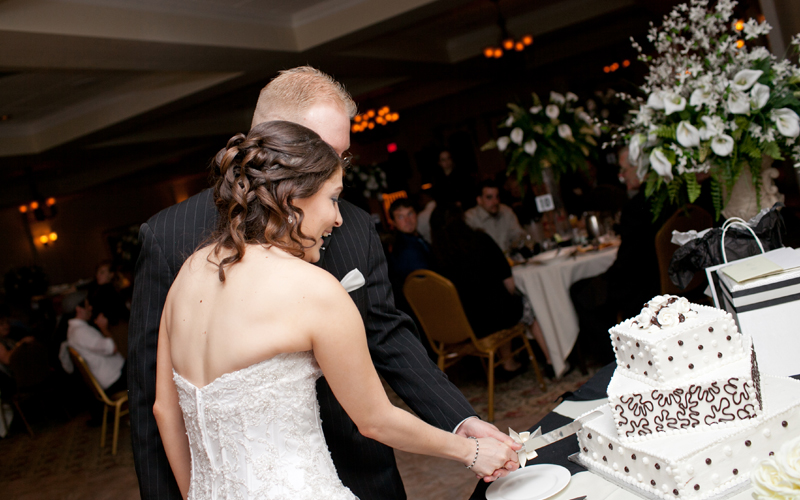 Bride and Groom Cutting Their Cake at Testa's
