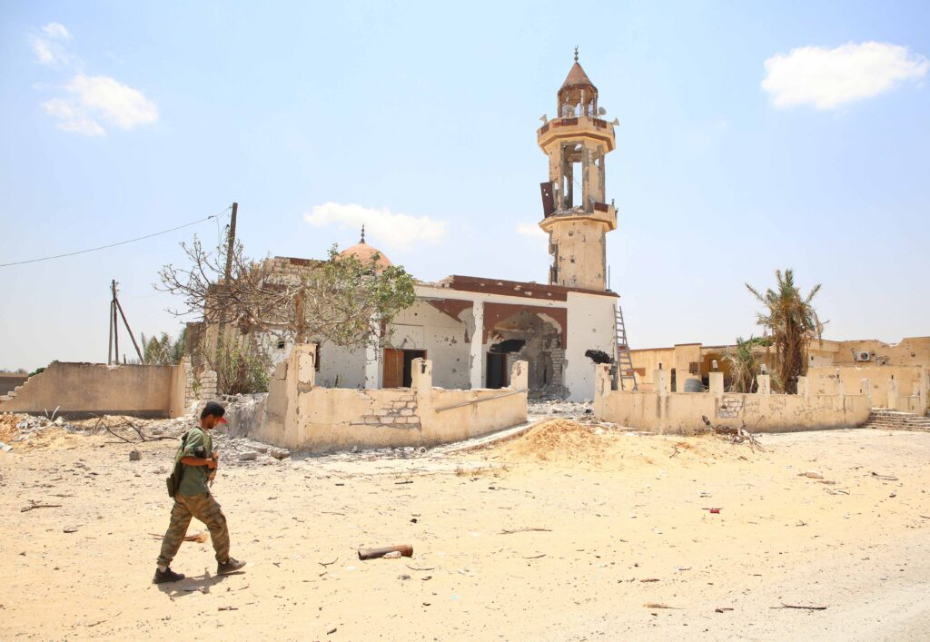 Earlier this month, multiple mass graves were discovered in a town used by Haftar's forces. (Photo from Getty Images)