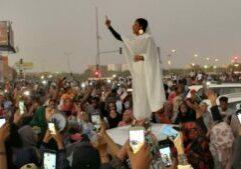 Alaa Salaah leads protest rallies amongst demonstrators in Khartoum