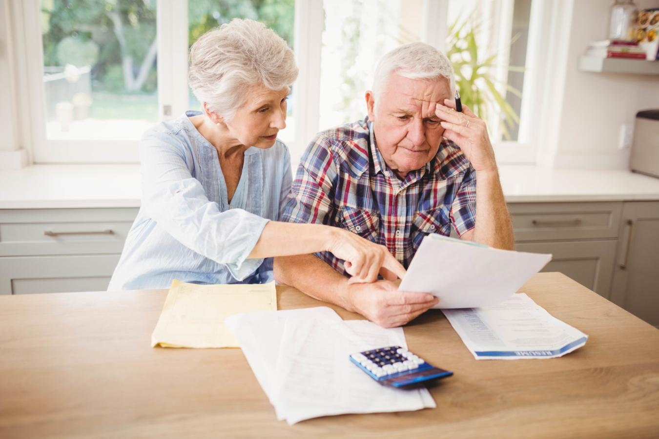 photodune-15037914-worried-senior-couple-checking-their-bills-at-home-l-e1468115927637