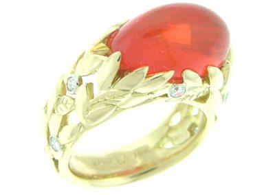 fire opal ring with gold leaves and diamond accents