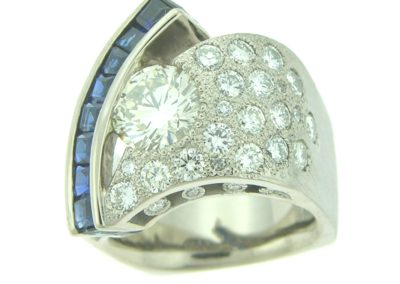 contemporary wedding band with pave diamonds and sapphire accents