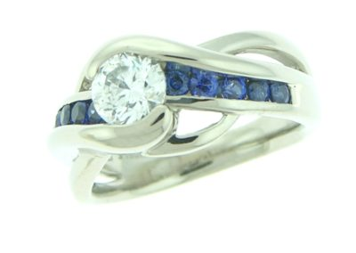bypass engagement ring with brilliant cut diamond and sapphires