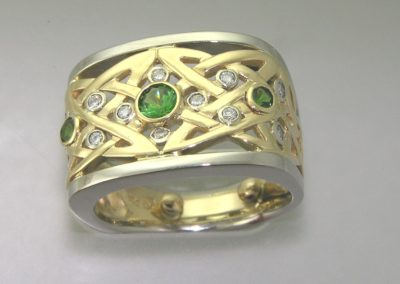 Irish knot wedding band with emeralds and diamonds