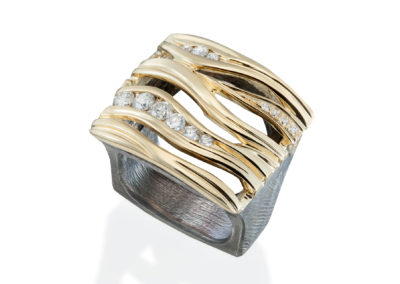 contemporary wave ring with gold, diamonds, oxidized silver