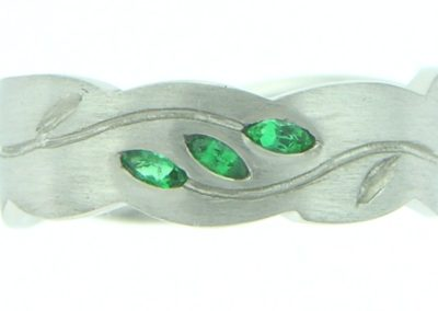 platinum band set with emeralds