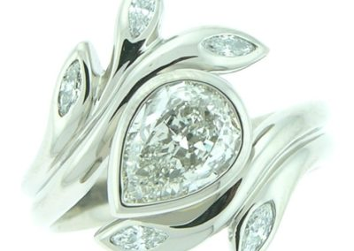 engagement ring pear shaped diamond and diamond accents