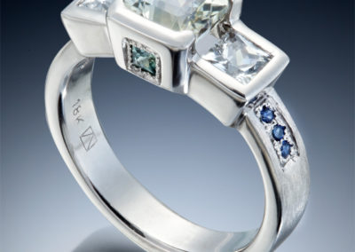 The stone ring with white and blue sapphires