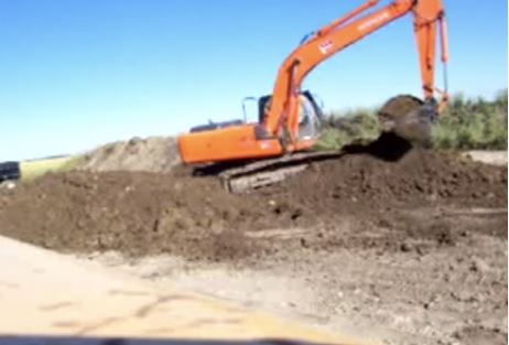 Excavator digging up dirt