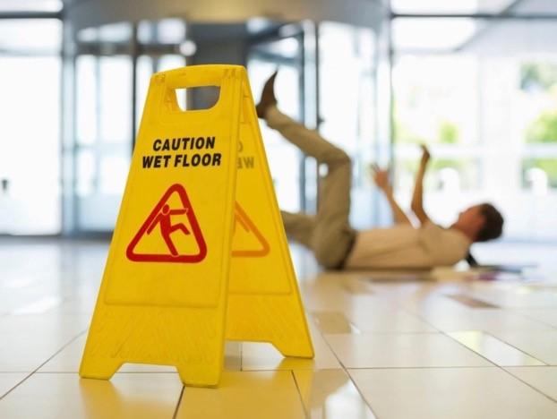 Wet floor person on ground
