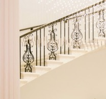 Fancy bronze railing on stairs