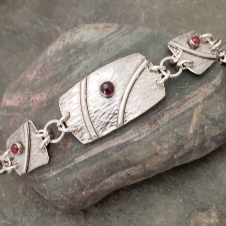 Nasca Collection garnet three panel silver bracelet