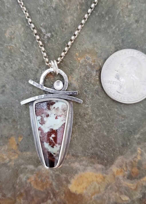 Equilibrium red and white silver pendant with copper cuprite and rainbow moonstone.