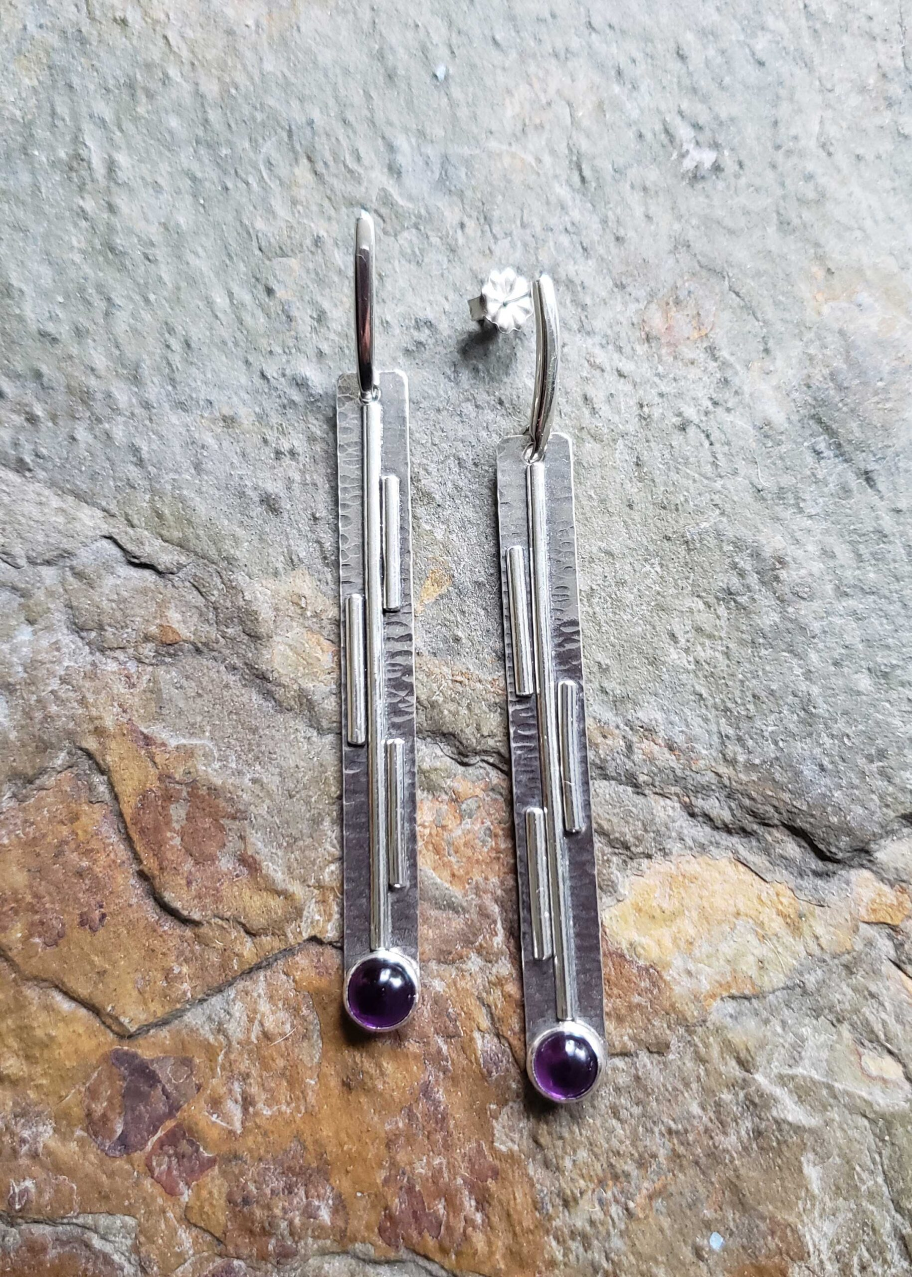 Long silver post earrings with purple amethyst, drawing the lines by Dona Miller.