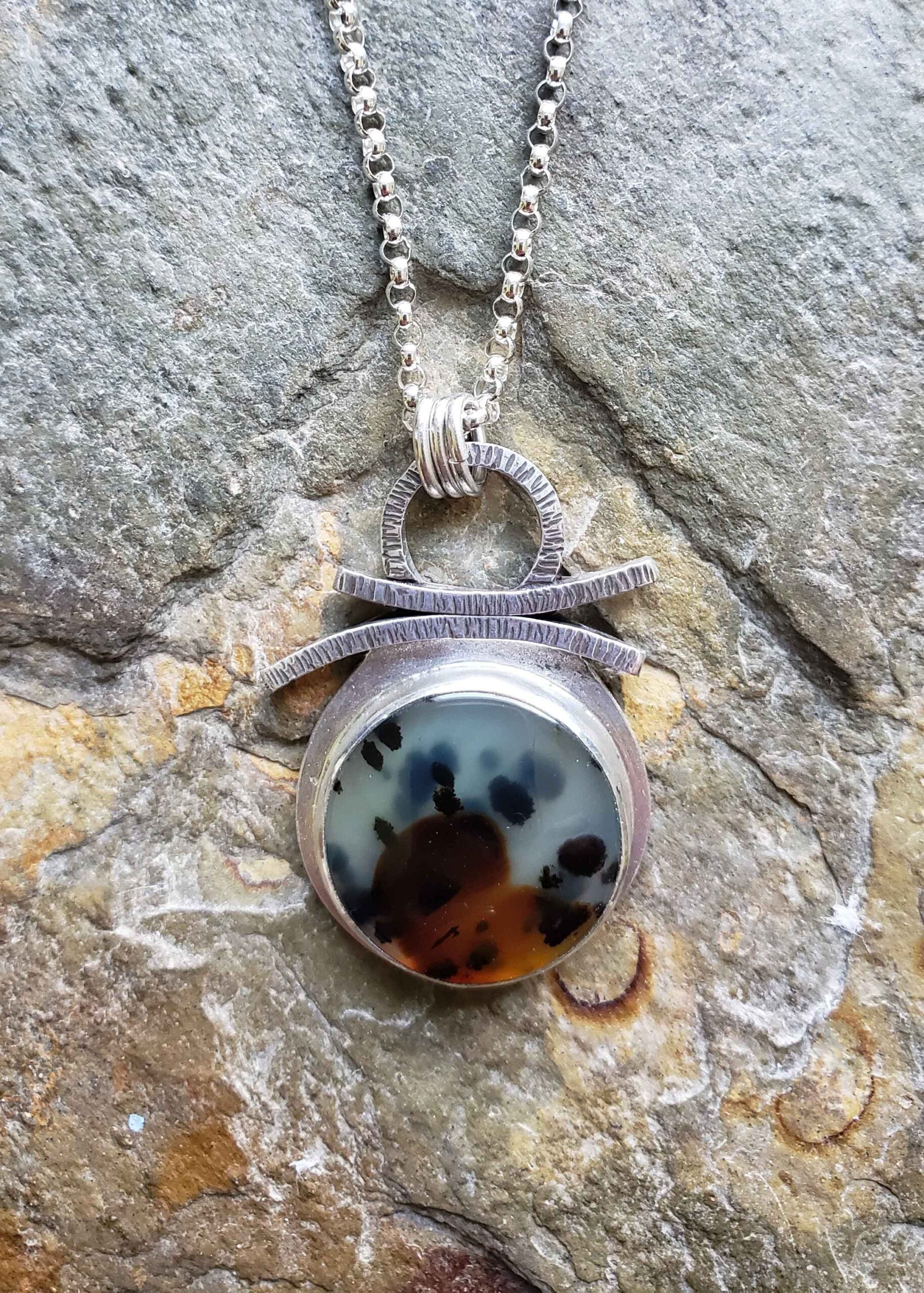 Silver pendant in mint green, rust and black by Dona Miller