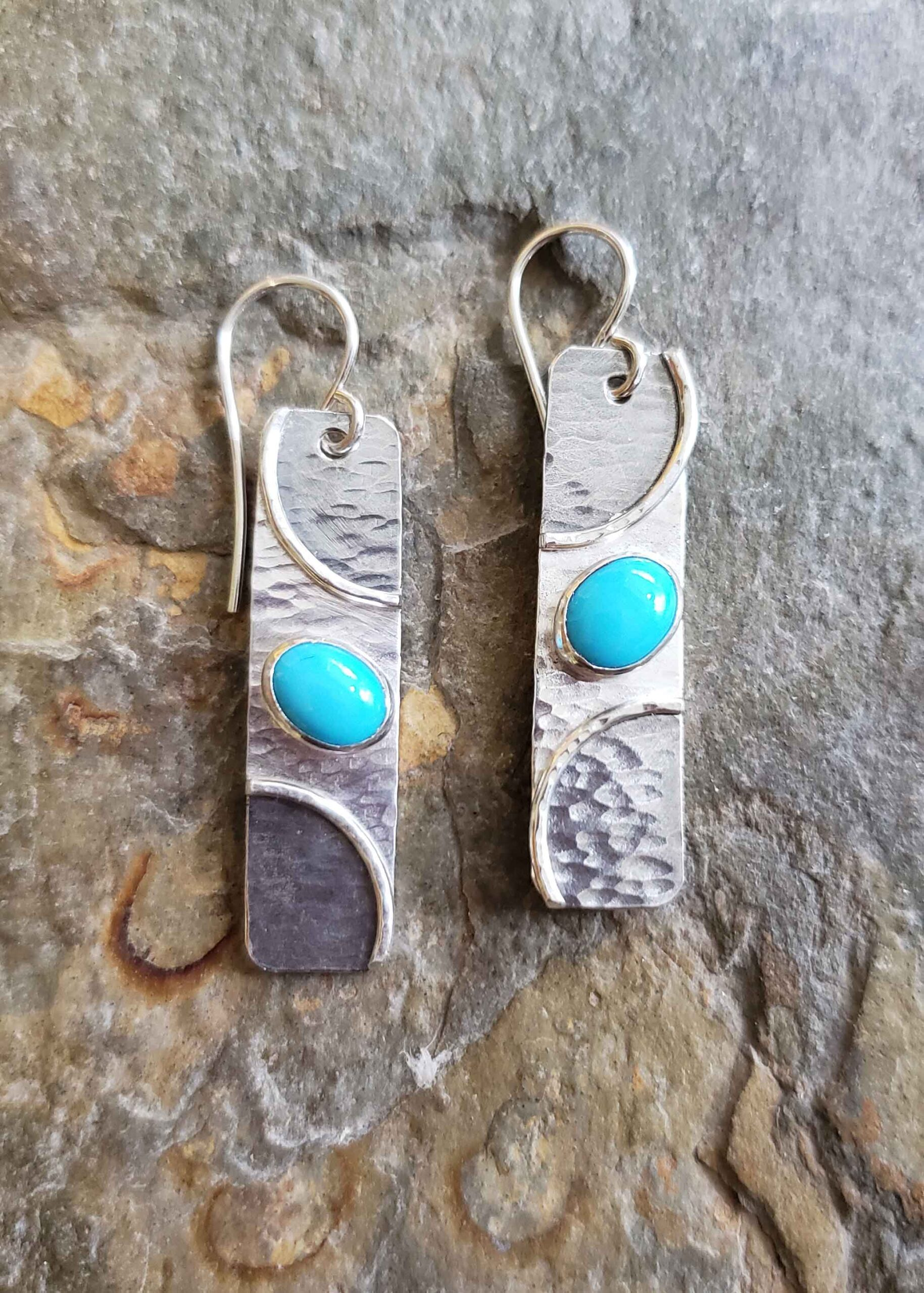Silver and turquoise earrings by Dona Miller.