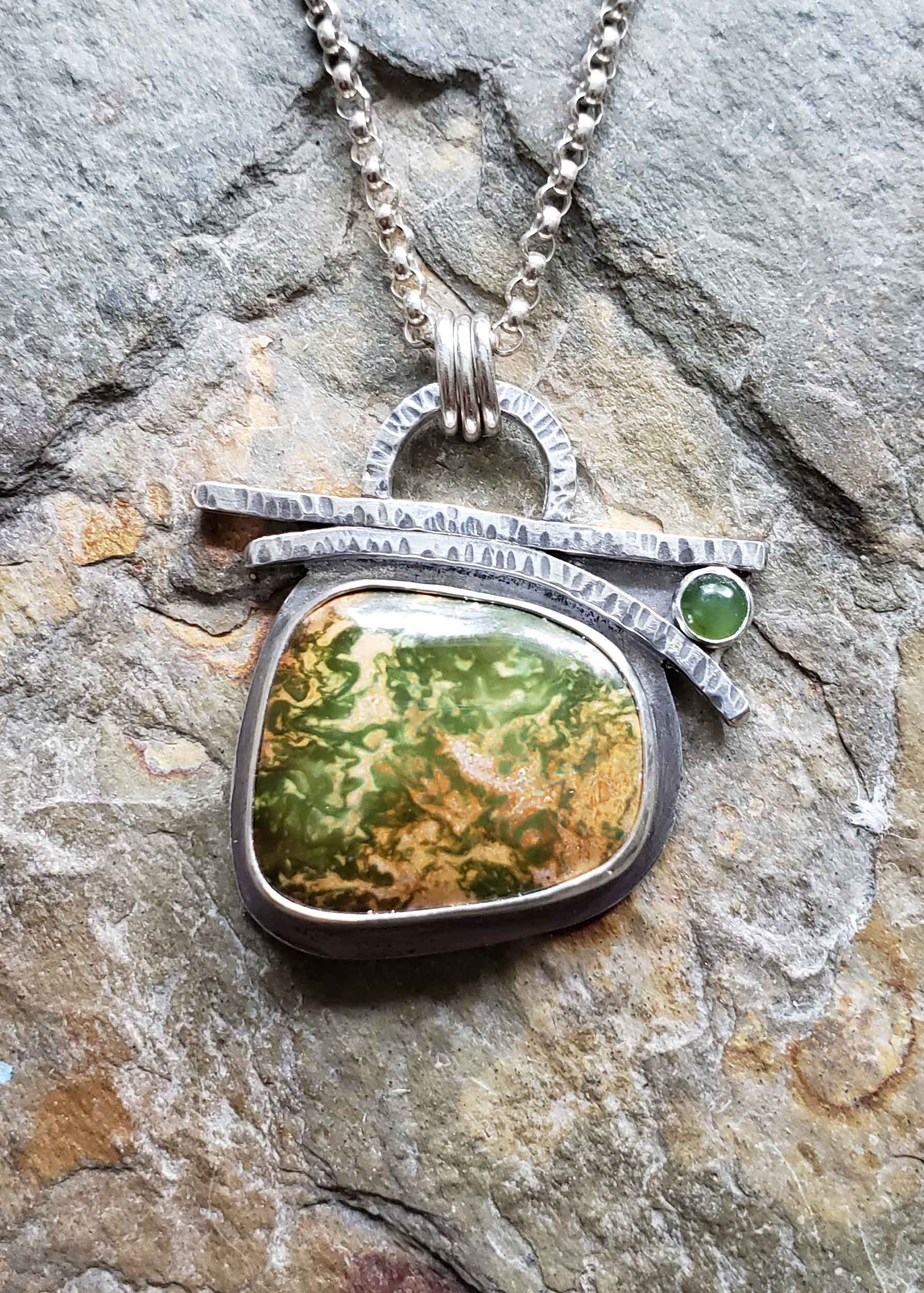 Silver forest pendant with Manassas Turquoise and Jade by Dona Miller.