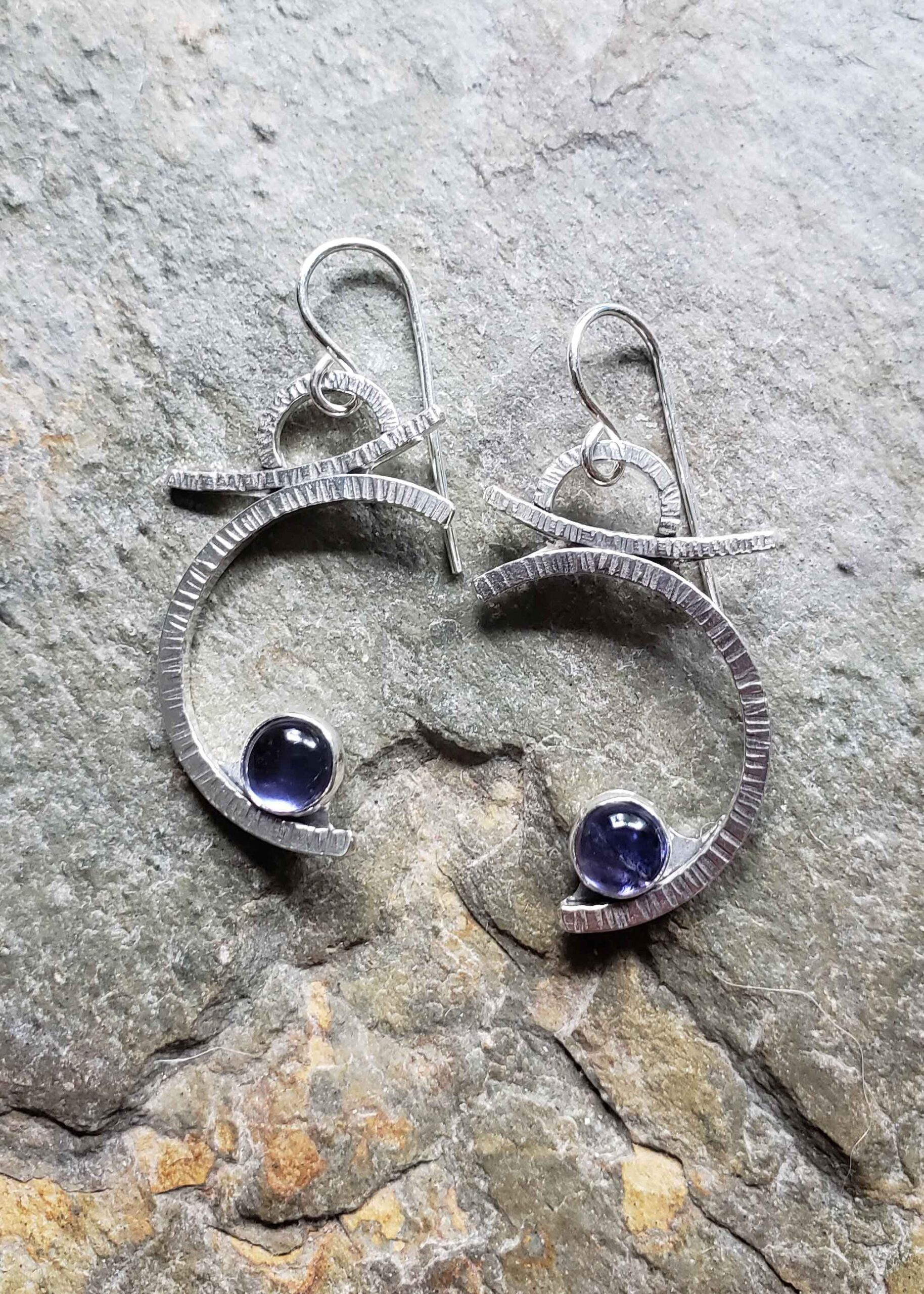 Silver earrings honoring the blue moon and the dreams we keep by Dona Miller.