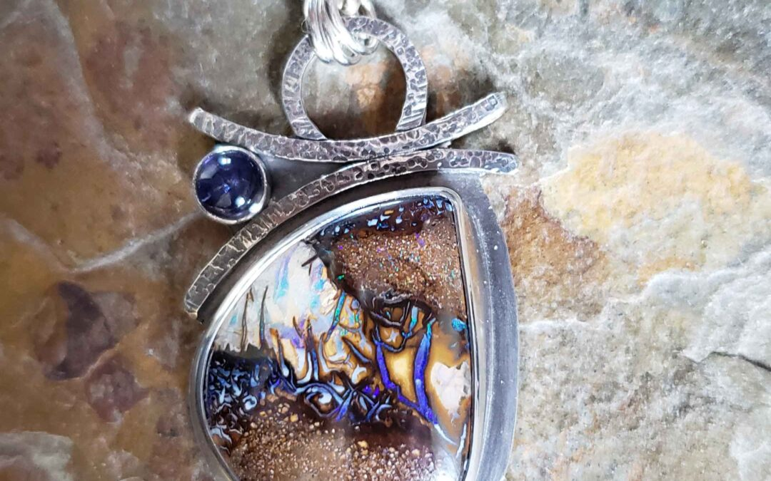 Silver boulder opal pendant in blues and browns by Dona Miller