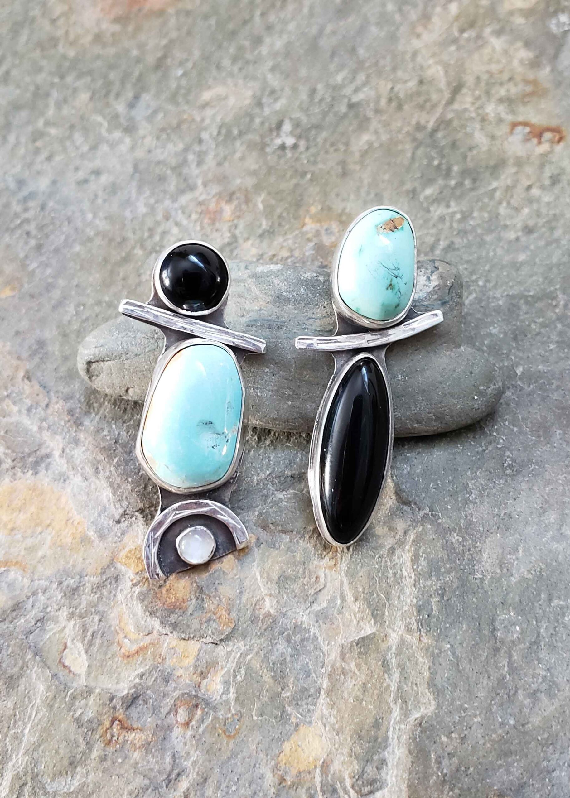 Turquoise, black and white silver asymmetrical post earrings by Dona Miller.