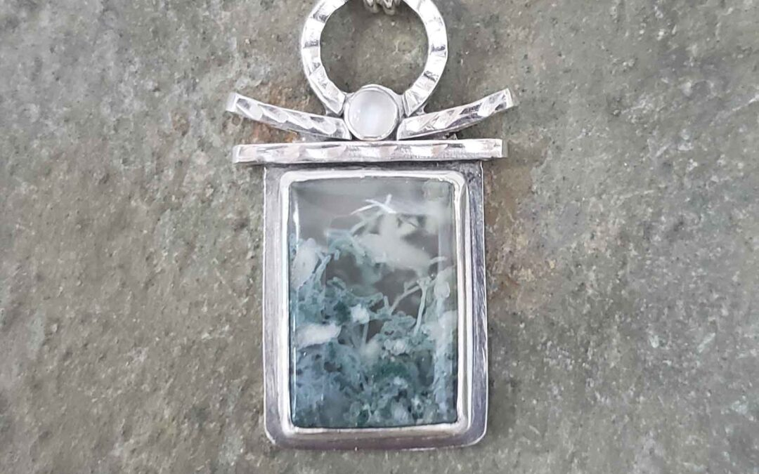 Silver pendant in green and white agate and moonstone by Dona Miller.